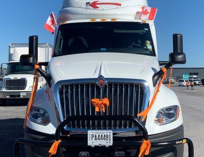 Kriska truck decorated with orange ribbons.